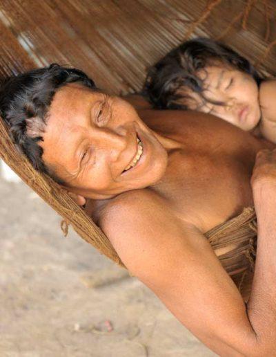 Suriname locals resting in a hammock — © ADN Amazonia