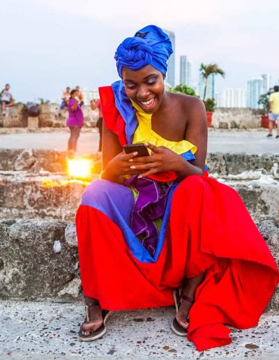 A woman on her phone in Cartagena, Colombia