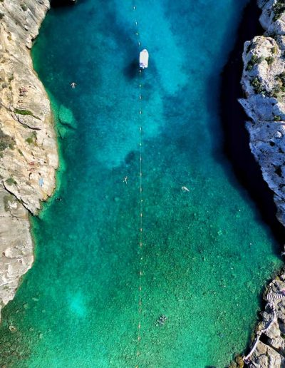 Clear body of water surrounded by rocks, Gozo, Malta
