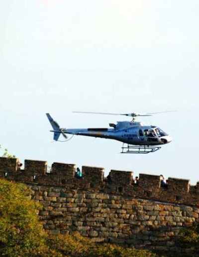 Flying over the Great Wall in a helicopter — Destination China