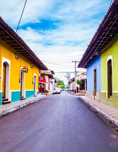 Pathway of colourful houses in León, Nicaragua