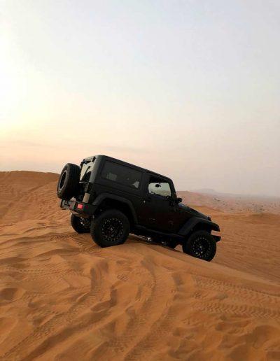 Black jeep in the Sharjah desert in UAE
